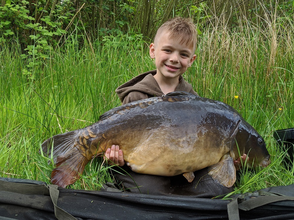 CHARLIE WITH HIS 27LB FISH