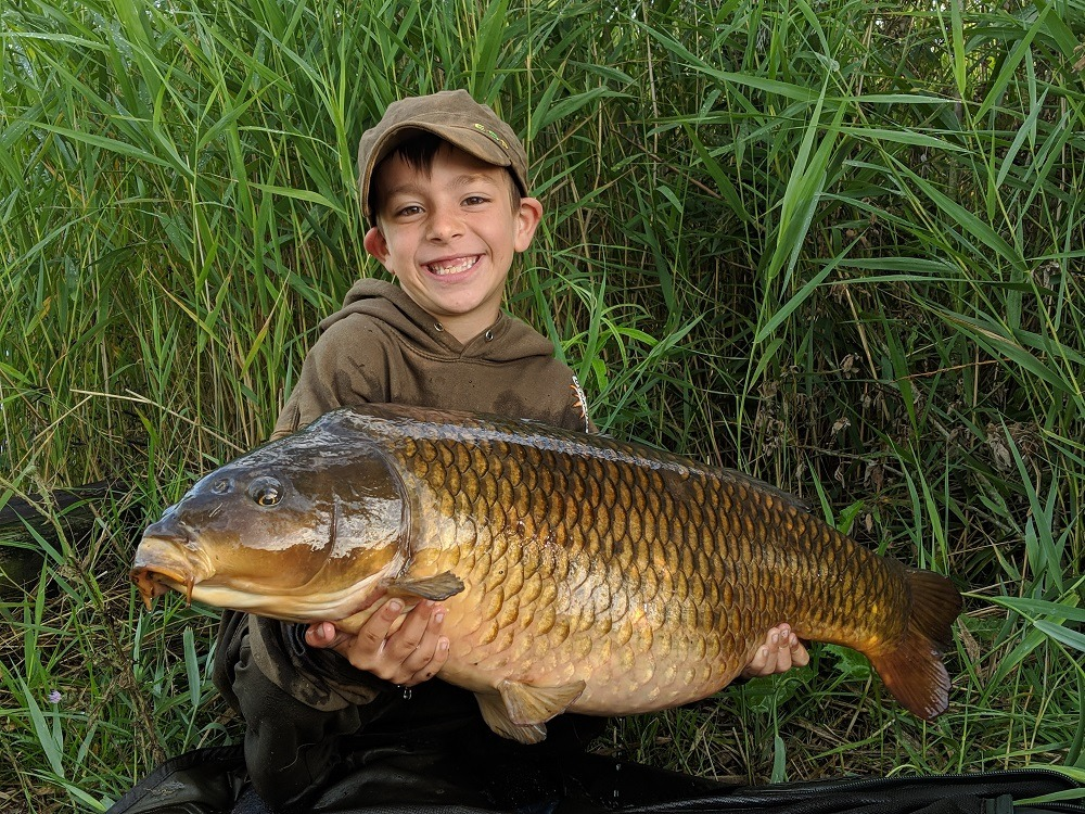 first common carp of the summer for alfie