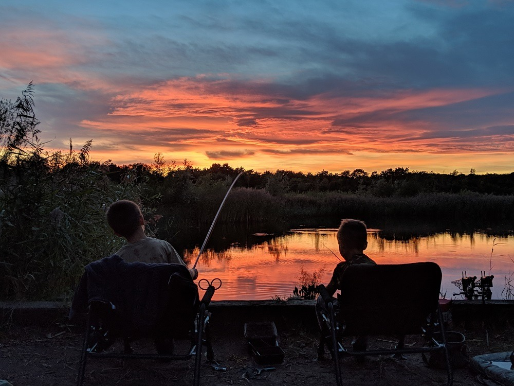 kids fishing for rudd on a summers evening