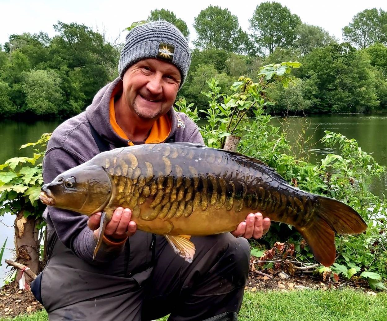 ian russell with a fuly scaled carp