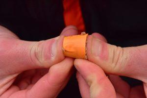 compress pellets into the pellet cone